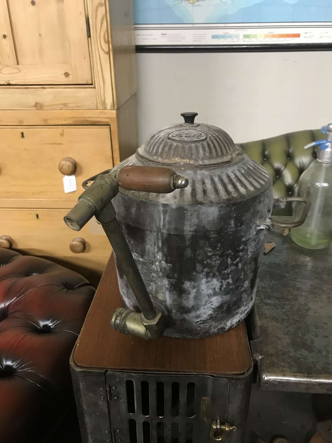 A cast iron Aga urn with brass tap by Holcroft