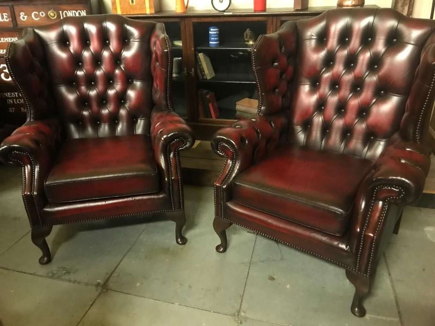 A matching Oxblood pair of Button Back  Wing Chairs