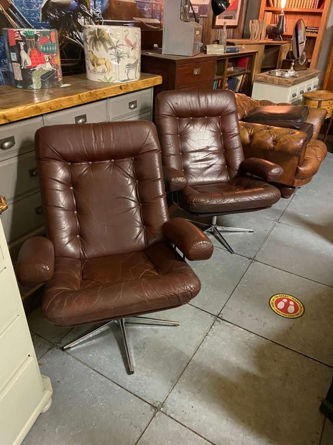 Original Pair of Mid Century Tan Leather Swivel Lounge Chairs