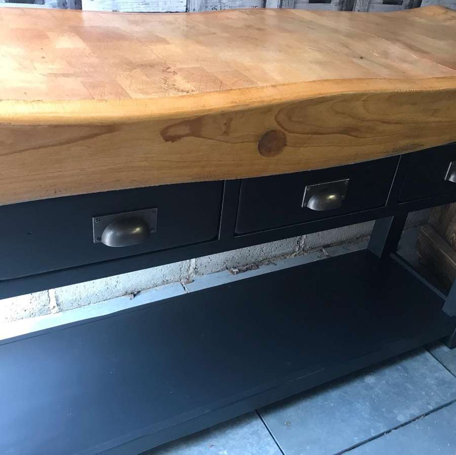 A Vintage Butchers Block on a Pine Console Table