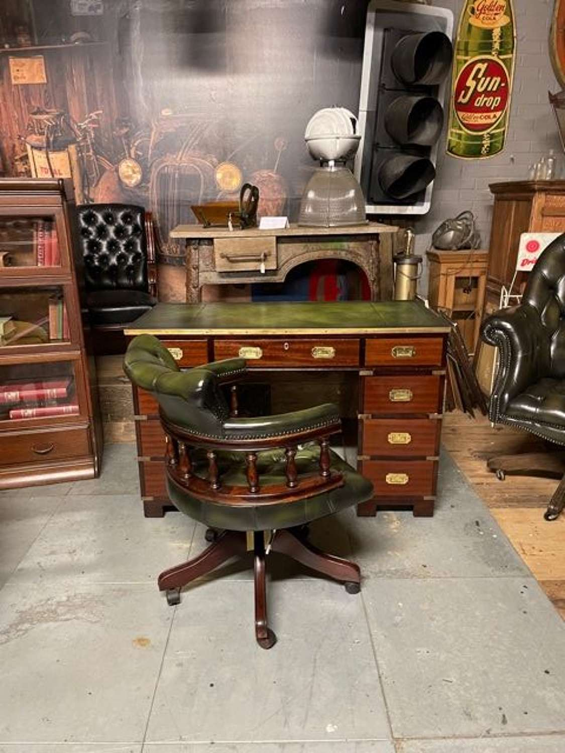 Military style campaign desk with a chesterfield Captains Chair