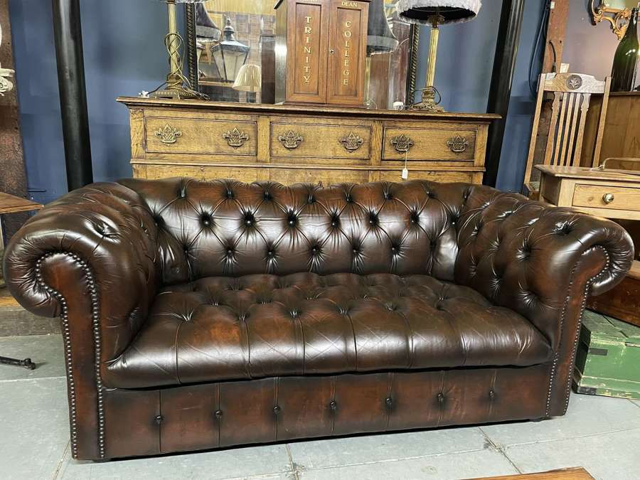 A vintage tan 2 seater full button leather Chesterfield sofa
